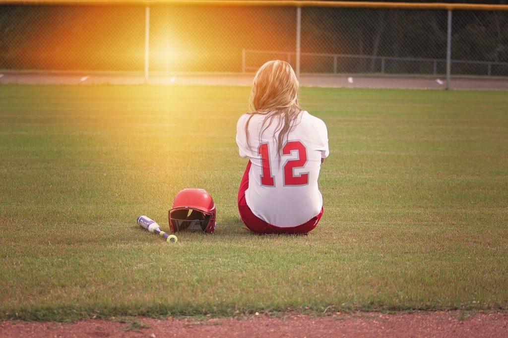 CHILD / ADOLESCENT TRAINING - teen sitting on field